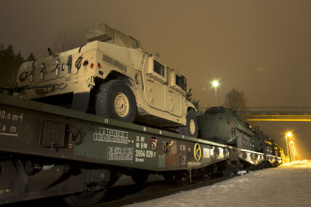 One of several transportation options for moving U.S. Marine Corps fighting vehicles and equipment is by train. Rena, Norway was the location where Light Armored Vehicles were loaded after training with the Telemark Battalion. The crews are now trained and the vehicles have been tested in harsh winter conditions.  They will join the host nation of Norway along with the other 10 participating nations for Exercise Cold Response set to begin on the 29th. The exercise will feature maritime, land, and air operations to underscore NATO's ability to defend against any threat in any environment.  The location in central Norway provides a unique, extreme cold-weather environment for all forces involved to develop tactics, techniques, and procedures and learn from one another.