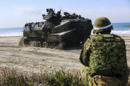 A Japan Ground Self-Defense Force solider provides security as an amphibious assault vehicle moves to a viable position to provide perimeter security during a scenario based, battalion-sized amphibious landing exercise (PHIBLEX) for Exercise Iron Fist 2016, Feb. 26, 2016. Capable maritime forces help ensure stability and prosperity around the world, and bilateral exercises, like Iron Fist, help partner nations improve their own maritime capability. (U.S. Marine Corps photo by Cpl. April L. Price/Released)